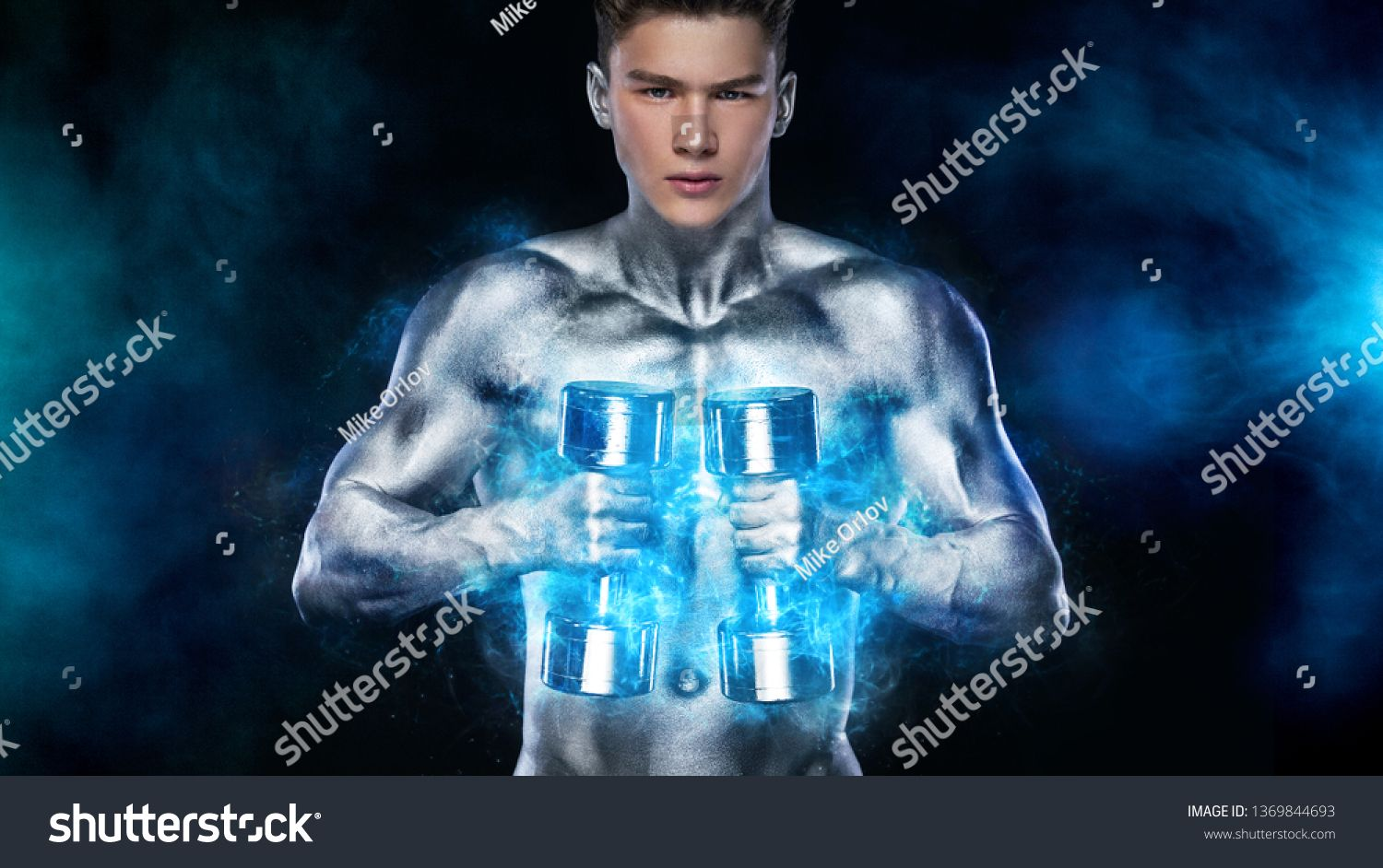 Muscular Man Showing Muscles On Sky Background. Strong