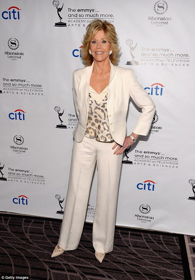 Jane Fonda wears a cast on her arm as she poses in a chic white ...