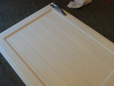 DIY add wainscot to cabinet doors. I believe we are going to do ...