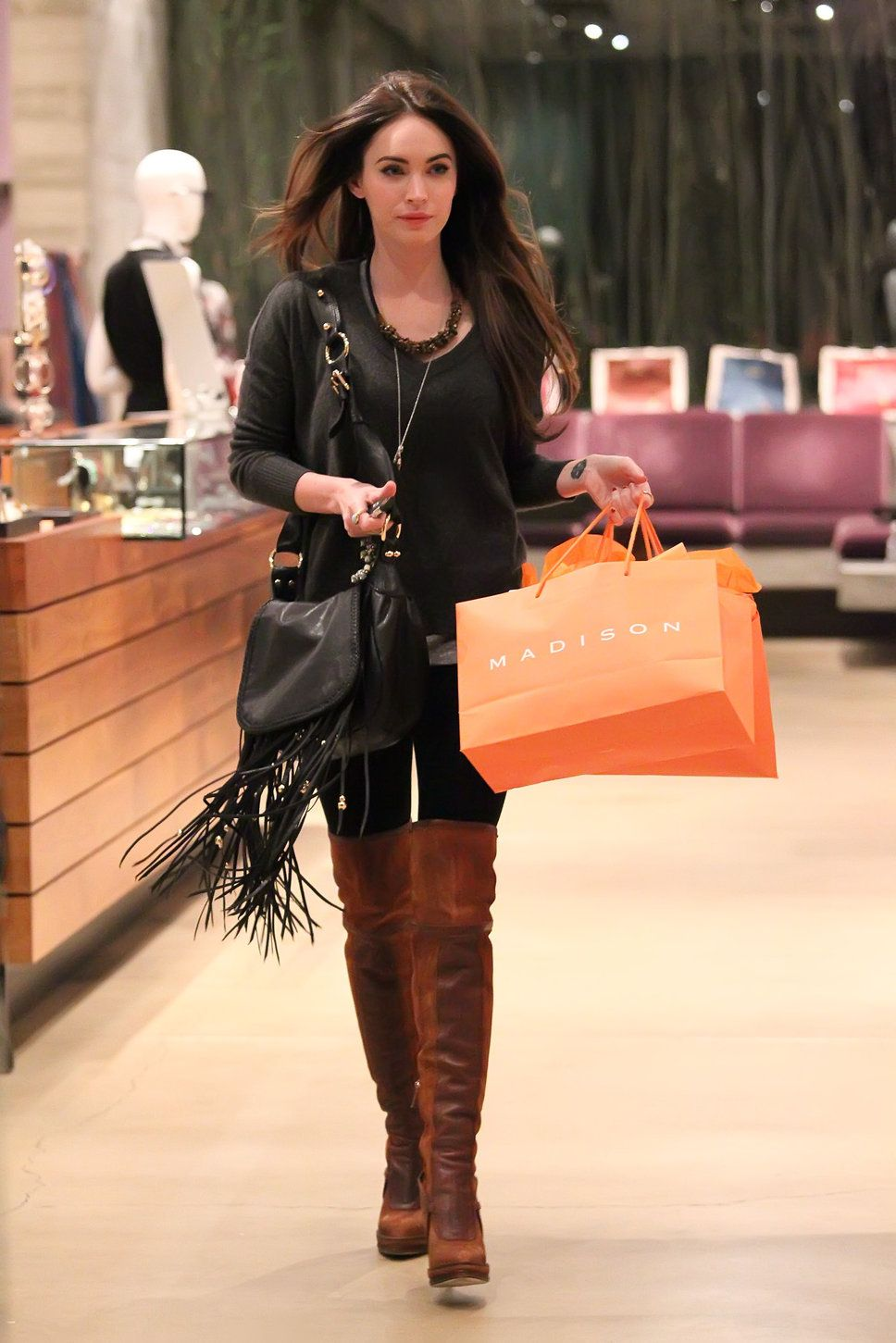 Megan Fox shopping black dress brown knee high boots black fringe bag