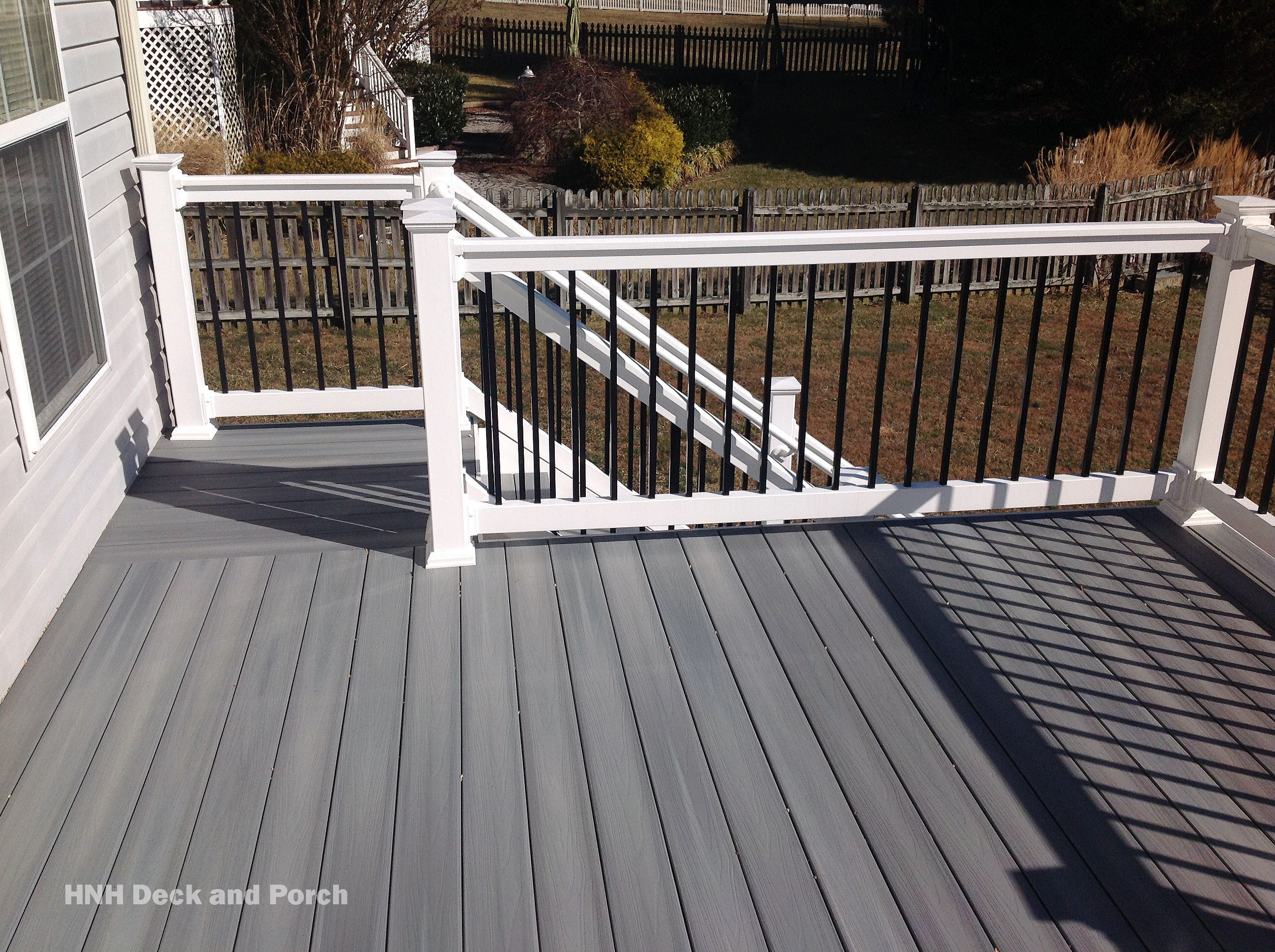 Composite Deck Using Fiberondecking Castle Grey Decking With White Pvc Railing And Black Square Aluminum Baers