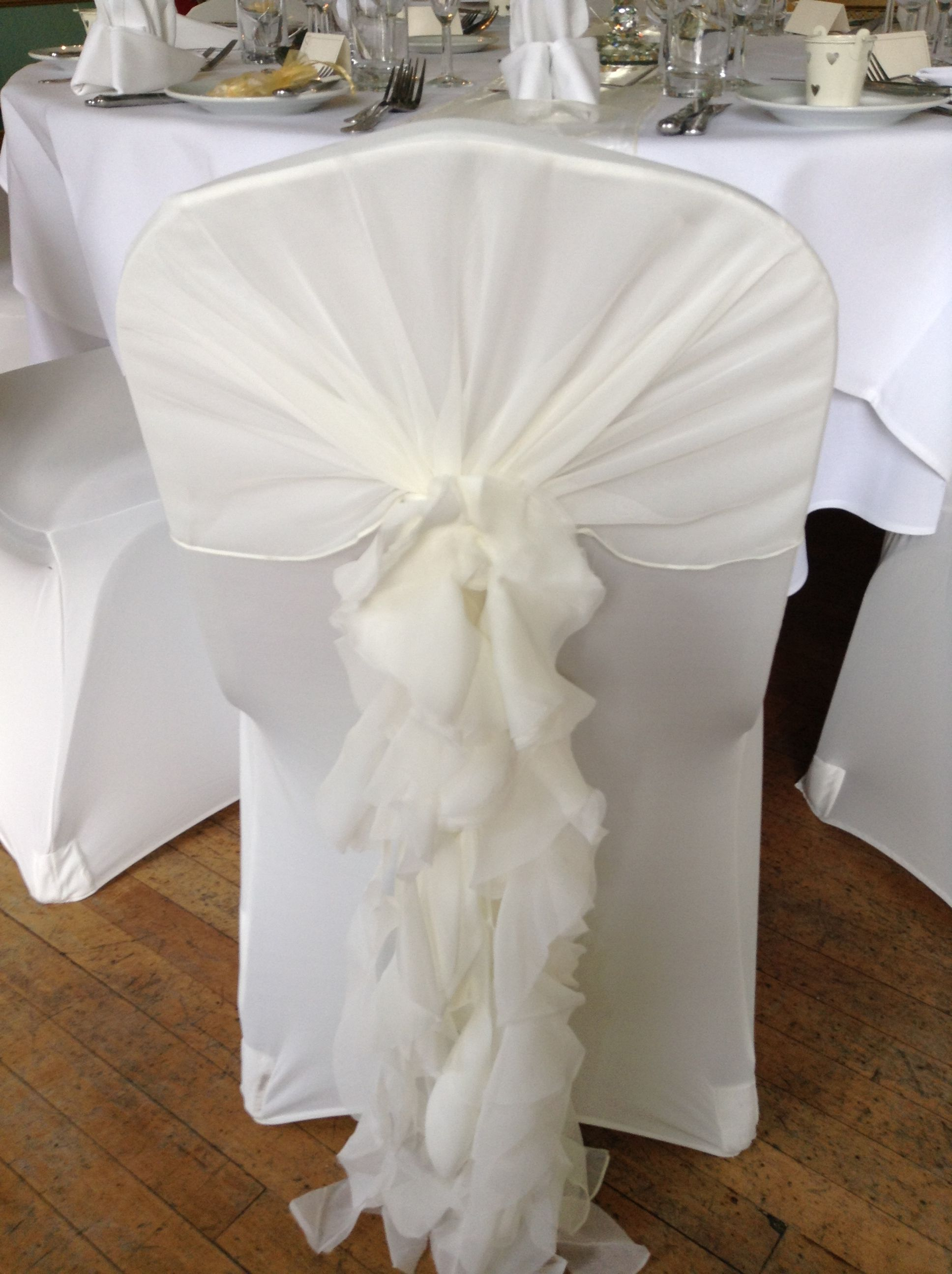 Traditional Champagne And White Wedding Chair Set Up With Sashes