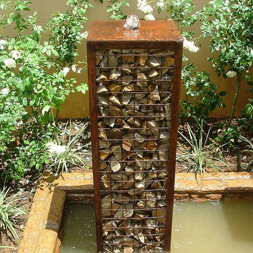 Gabion water fountain now this i don 39 t mind i am so not a fan of the gabion fad that seems to - How to build an outdoor fountain with rocks ...