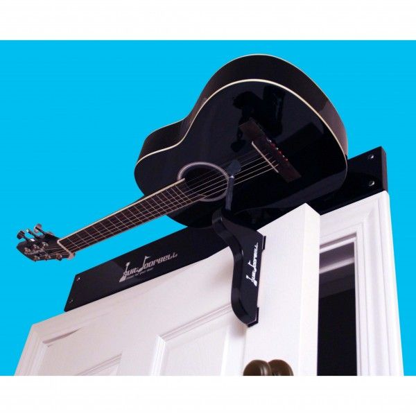 Guitdoorbell | Delight your guests with this half-sized acoustic guitar that easily mounts over any inward opening door. A striker-pick strums the guitar every time the door opens making a musical announcement. Tune it to your favorite 60's rock band chord! You can even take it down and play it! A unique and entertaining add on to any doorway - great for home, retail shop, office or pub. Shop at SkyMall.com!