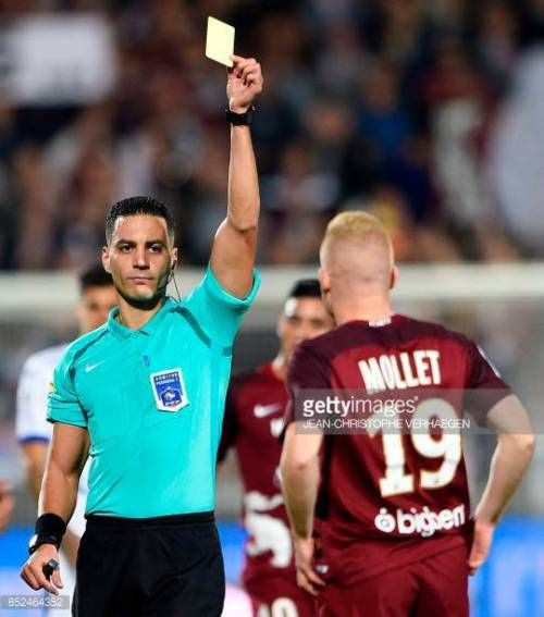 10 12 Main Referee Karim Abed L Gives A Yellow Card To Mollet 10 12 Main Referee Karim Abed L Gives A Yellow Card To Referee Football Match Midfielder