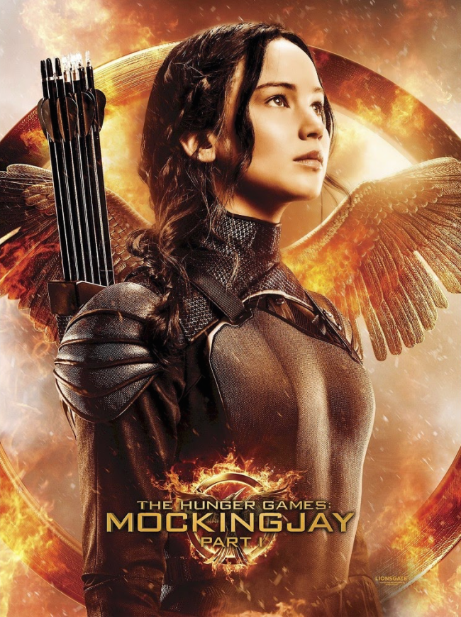 Panem Propaganda The Hunger Games News Exclusive Katniss Poster With Target S Mockingjay Part 1 Hunger Games Hunger Games Trilogy Hunger Games Mockingjay