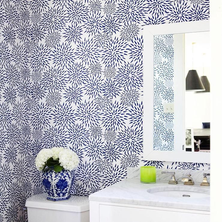 Navy powder room features walls clad in Navy Mums The Word