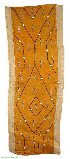 Kuba Raffia Textile Openwork and Cowrie Shells   Appliquéd raffia textile.     Country of origin: DR Congo.  Materials: Raffia palm fibers, dyes    Contemporary piece of fabric
