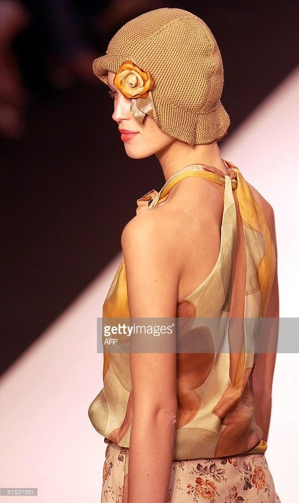 A model displays a creation by designer Ronit Zilkha 12 September 2002 during London Fashion Week spring designs presentation at a venue in Kings Road. AFP PHOTO Martyn HAYHOW