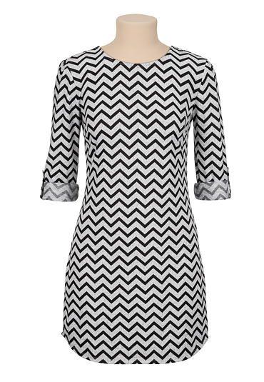 <ul><b>Overview</b><li>Jersey dress</li><li>Grey and black chevron print</li><li>3/4 sleeves</li><li>Zippered back</li><li>Falls above the knee</li></ul><ul><b>Fit and sizing</b><li>34.5 inches from shoulder to hem</li><li>measured from size medium</li> </ul> <ul><b>Fabric and Care</b><li>Style Number: 28707</li><li>Imported</li><li>97% polyester; 3% spandex</li><li>Machine wash</li></ul>