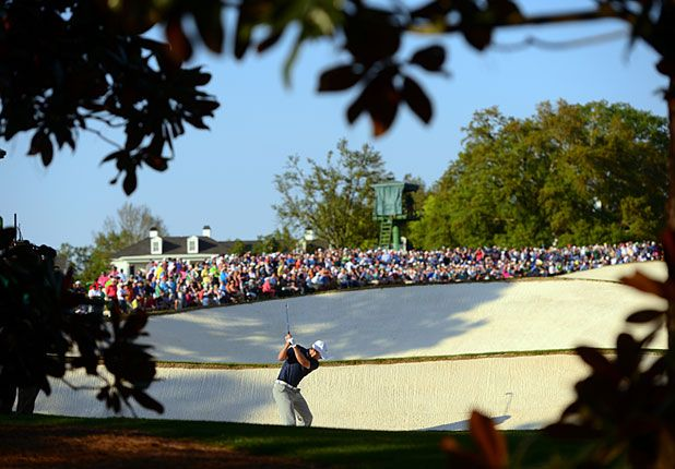 Jordan Spieth hits out of a fairway bunker on No. 18 on Saturday. #Masters