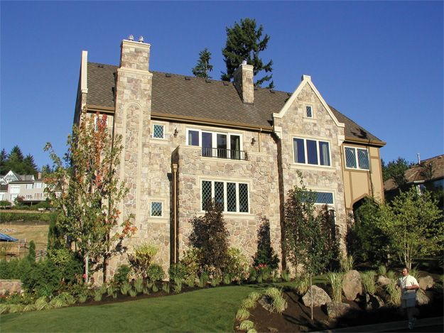 Castle like with balconies and flower beds tudor house for Castle like house plans