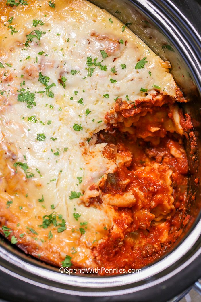 Lazy Crock Pot Lasagna is a family favorite and so quick and easy to make! A delicious meat sauce is layered with cheese and spinach filled ravioli and loads of gooey cheese and cooks up perfectly in the slow cooker. This is one meal that everyone will agree on. #spendwithpennies #lasagnarecipe #crockpotrecipe #slowcookerrecipe #crockpotlasagna