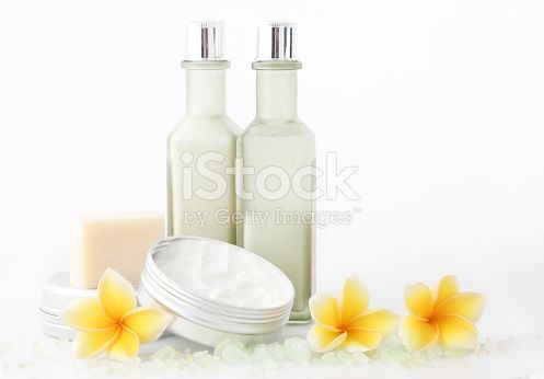 Set of different cosmetic product with frangipani flowers