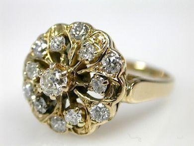 One 14 karat yellow gold rosette cluster ring. One old European cut diamond (0.21 carats: VS1 clarity: H-I colour). Six old European cut dia...
