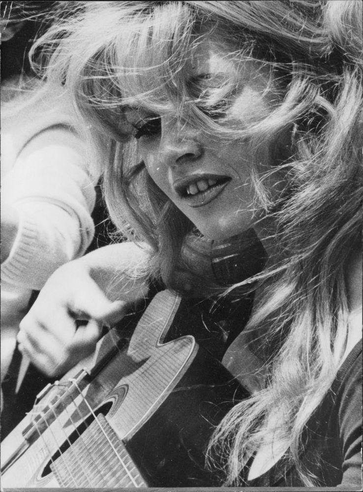 Vintage Photo of Brigitte Bardot Playing Guitar