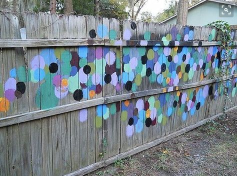 Fence Art - 25 pieces of art using a backyard fence as the canvas