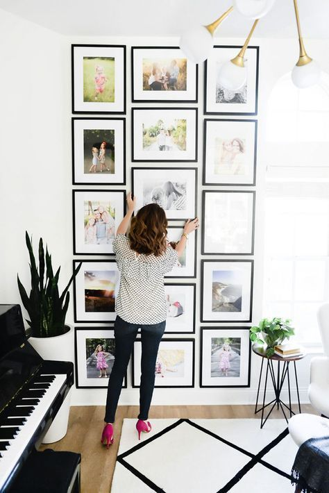 DIY photo gallery wall idea to help you design the best piece of art in your home! colour photos, large, black frames, full wall - #blackframes #largegallerywall #coloredphotos || Nikki's Plate