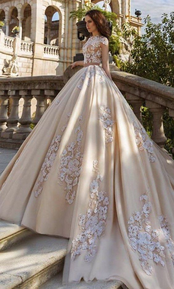 42f5cba1764 floral applique cropped ballgown wedding dress in a pale yellow color via  tm crystal design