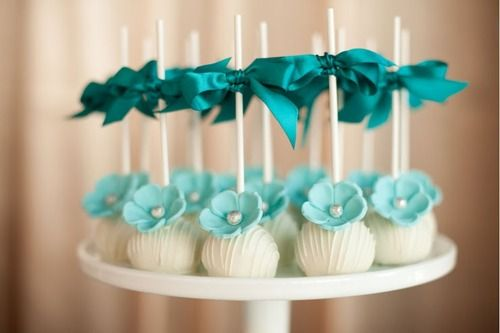 Love the bows and decorations on the cake pops.
