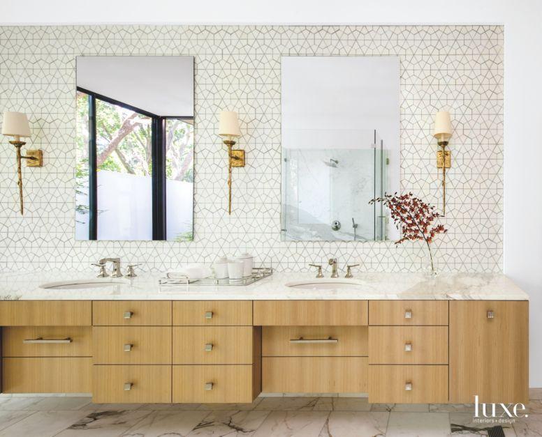 Calacatta Gold marble tops the master bathroom\'s rift-sawn ...