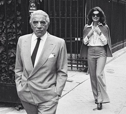 Jackie Kennedy Onassis walking behind her second husband, Aristotle Onassis in Paris. Onassis maintained luxurious home near the Eiffel Tower.