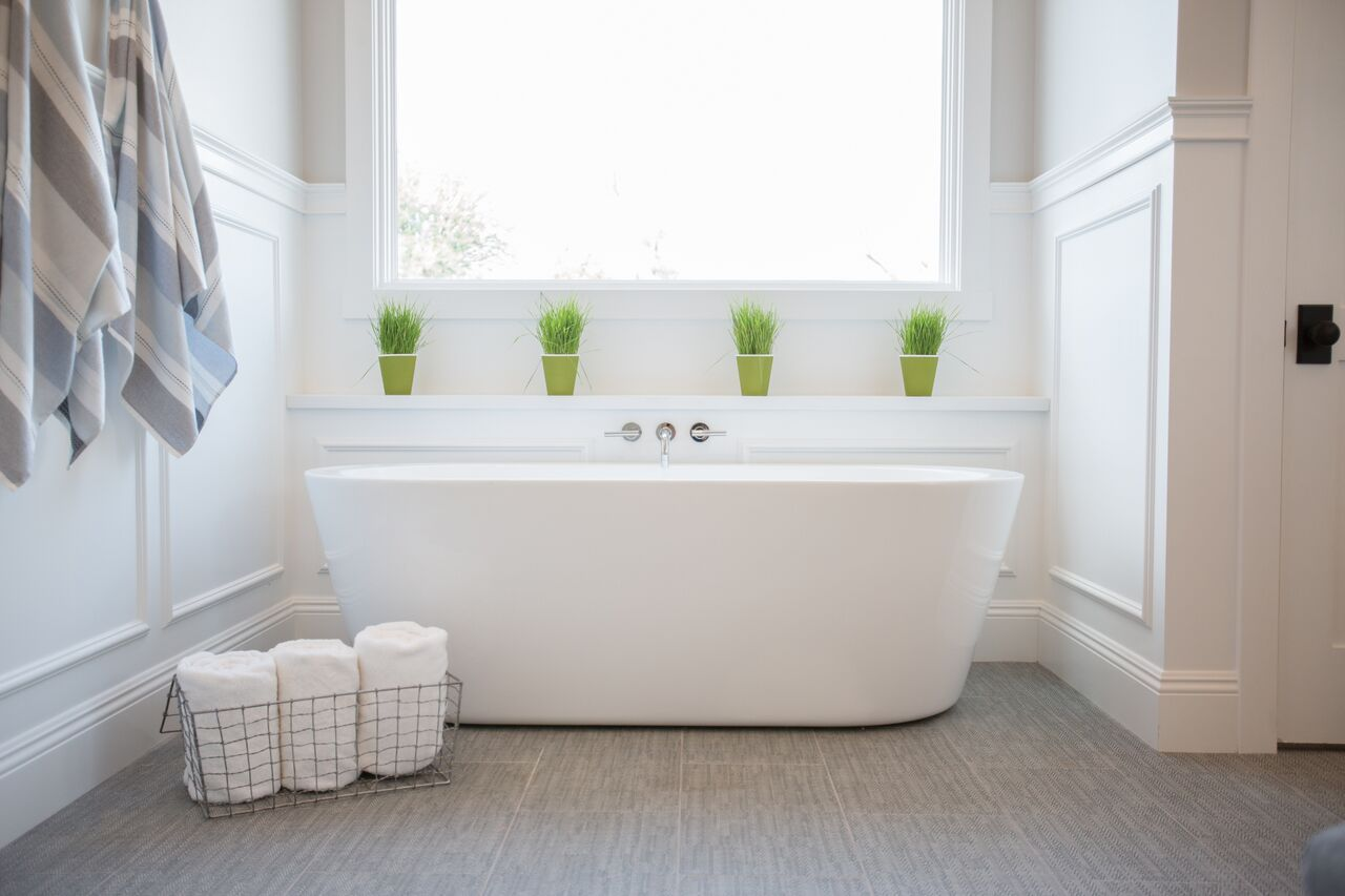 Contemporary, white master bath with Shaker cabinets, wainscotting ...