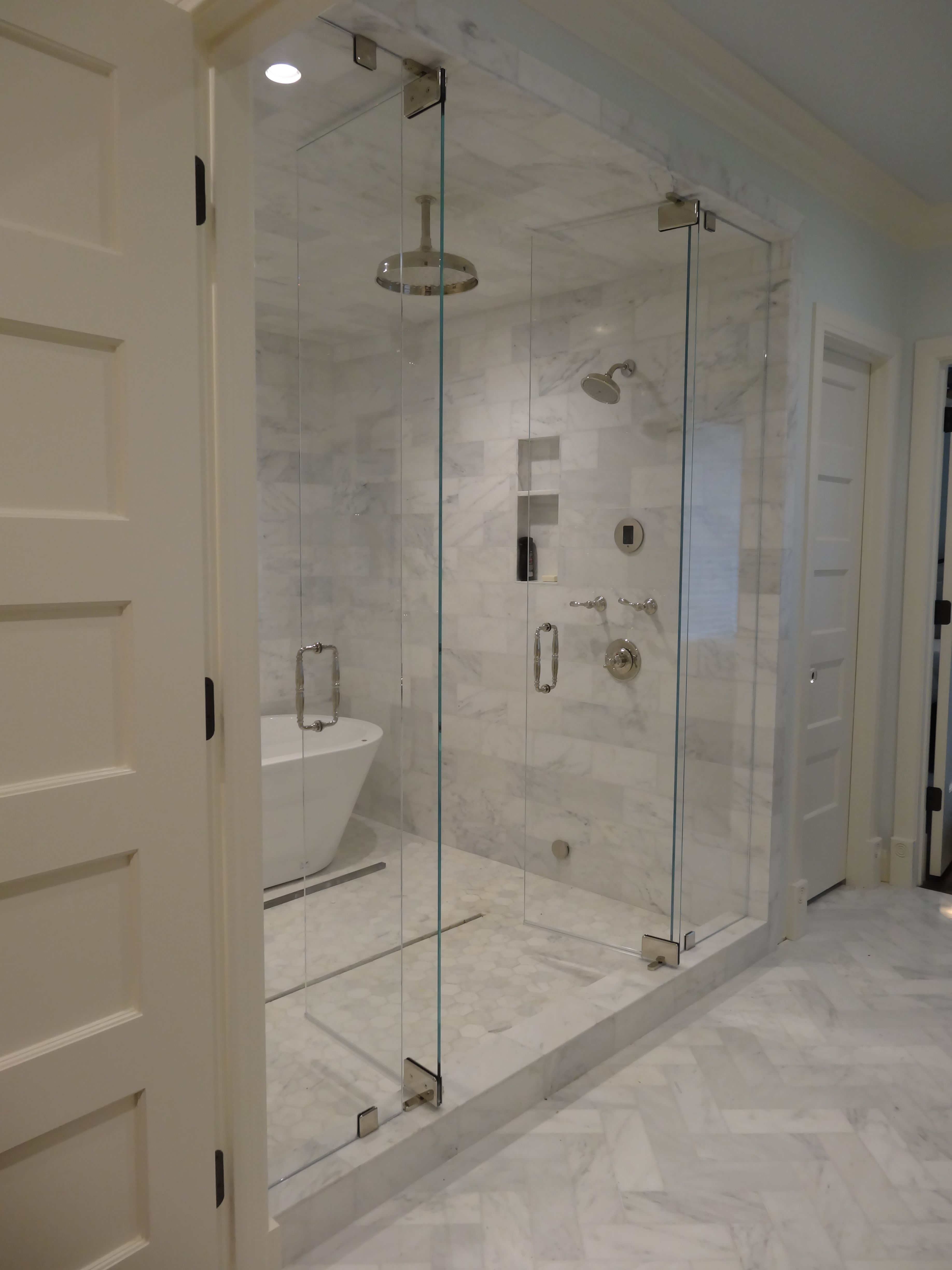 Steam Shower With Marble Tiling Swing In And Out Doors With A