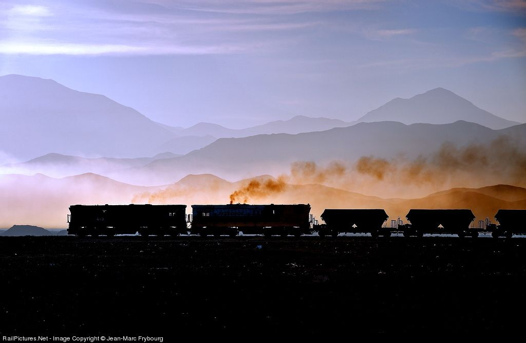 RailPictures.Net Photo: Ferronor 419 Ferronor Chile EMD GR12 at Vallenar, Chile by Jean-Marc Frybourg.  In summer (southern Hemisphere summer is in December), there is often some fog where the Atacama Desert nears the Pacific Ocean. Early morning light can be particularly wonderful before the tropical sun gets too high.