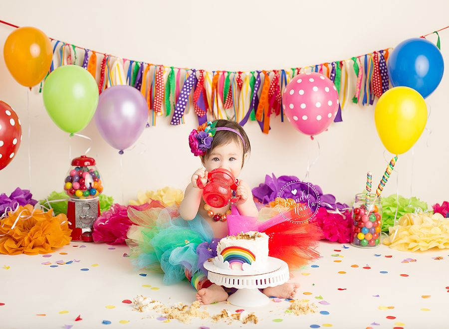 Baby girl in rainbow themed baby cake smash photo by ...