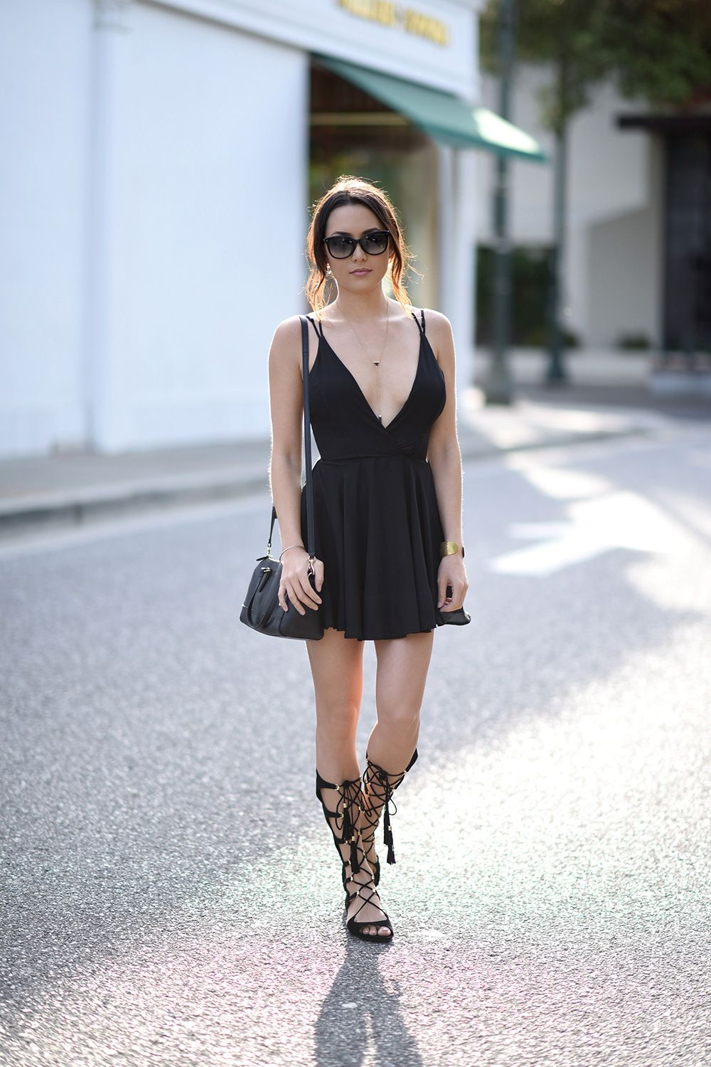 f0443fdb64ba Don't be afraid to wear a pair of calf high gladiator sandals! Jessica R.  shows us just how effective strappy sandals can be, pairing these with a  classic ...