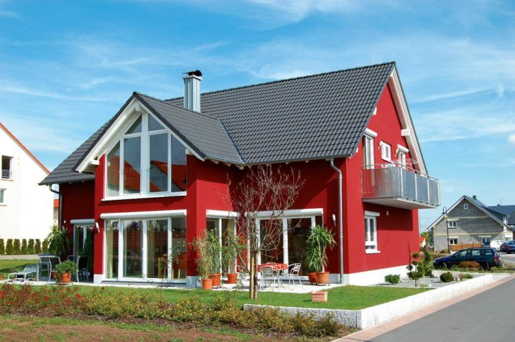 Red Painted House With White Window Trim