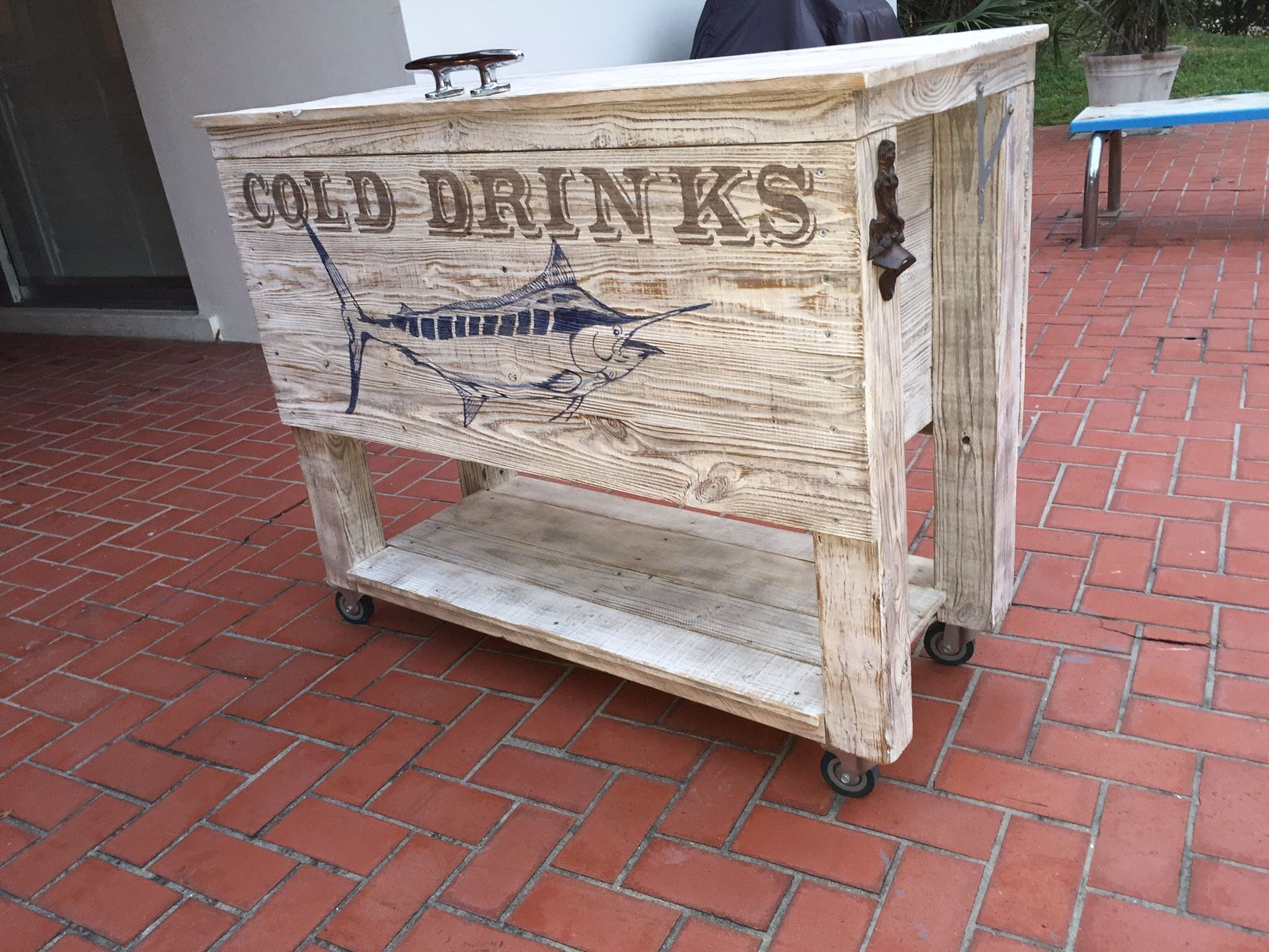 Patio cooler handmade with old fence boards and pallets then