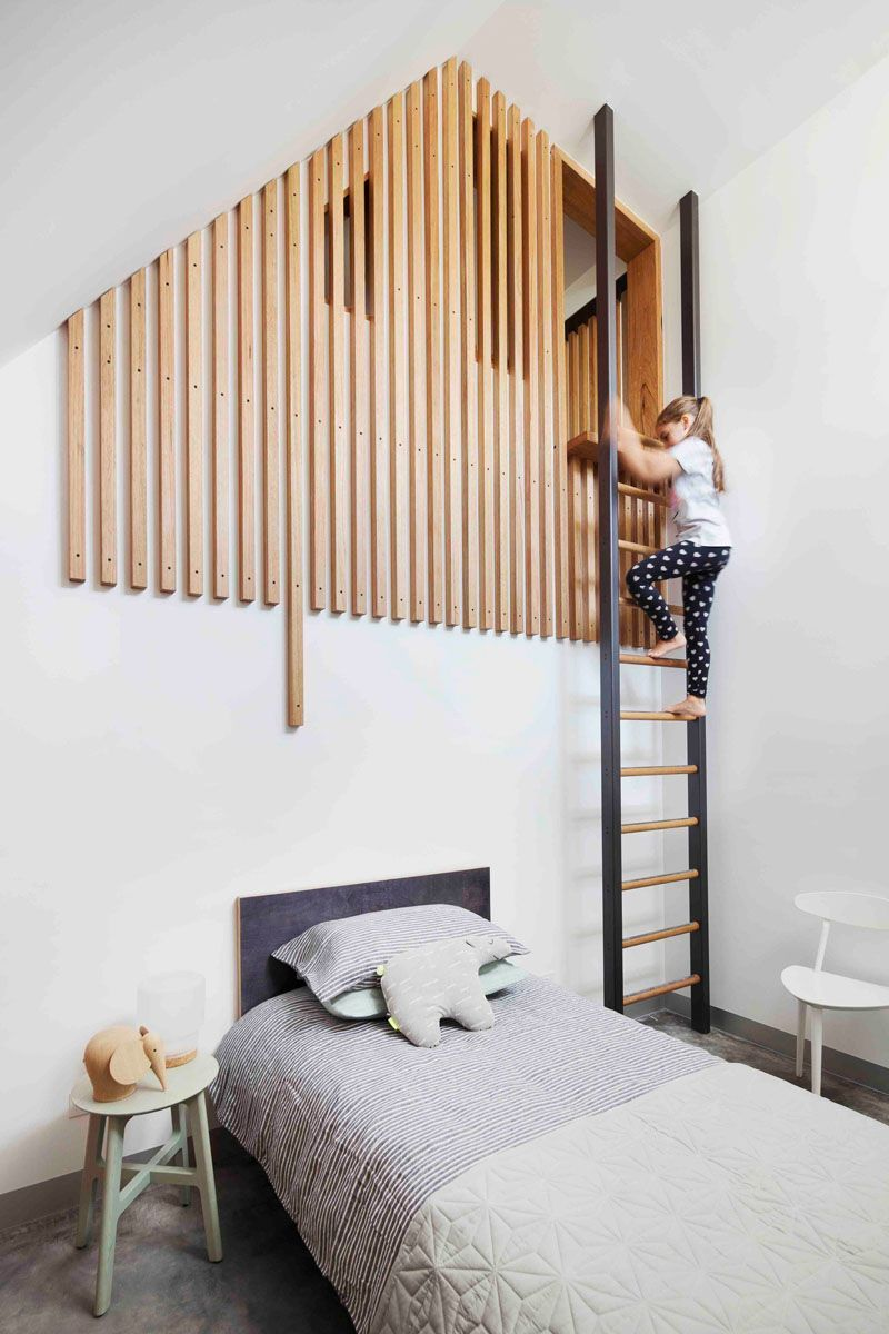 This modern kids bedroom has a loft area is reached via a ladder