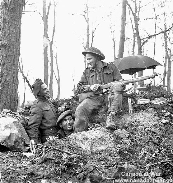 Infantrymen of the Queen's Own Cameron Highlanders of Canada at their dugout in the Hochwald, Germany, March 5, 1945.