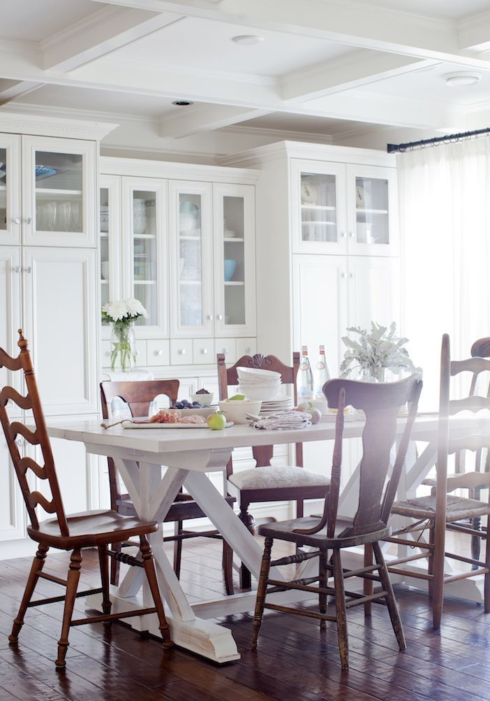 Beautiful White Farmhouse Table Surroundedvintage Wood Chairs Alluring Farmhouse Dining Room Table And Chairs Inspiration