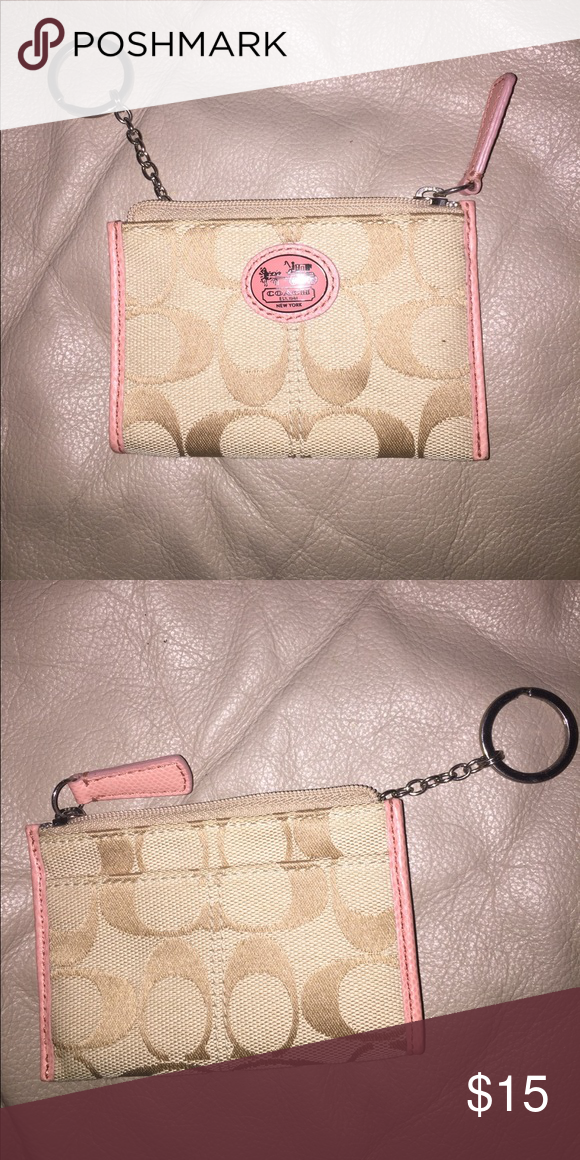 428c4722ddf Coach coin wallet Never used small coach coin wallet! Peach and tan  colored! Coach Bags Mini Bags
