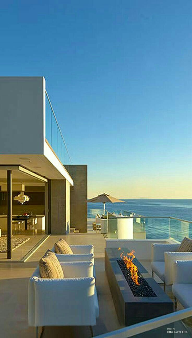 """Beachfront Luxury Modern Home Exterior At Night: Wall That Opens Up. Top """"viewing Platform"""" Have U-shaped Banquette Seating And This Fire Feature"""