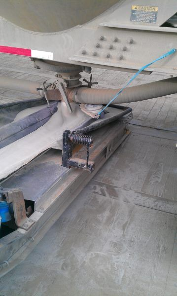 Gravity unloading frac sand from pneumatic trailer onto a swing away