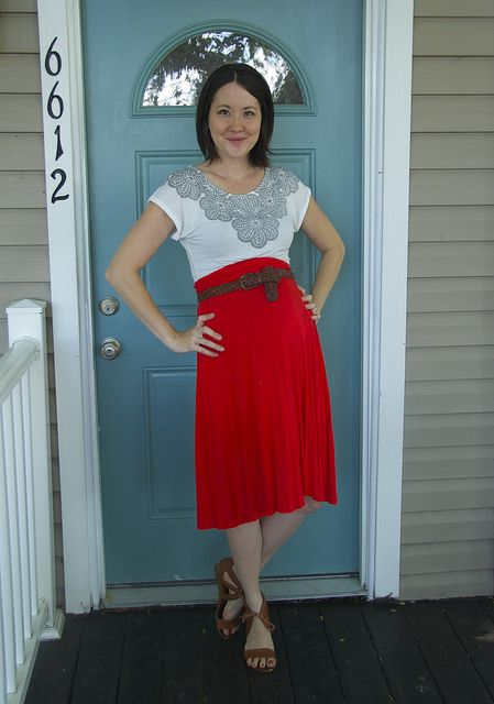 Belted red knit skirt.