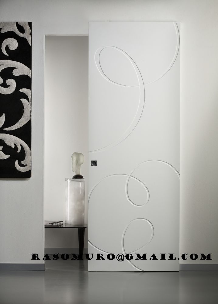 Sistema per porte scorrevoli esterno muro - binario INVISIBILE ...