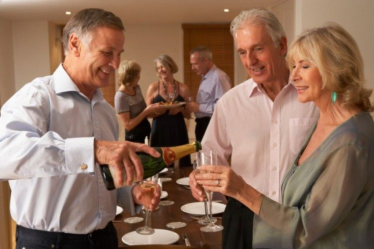 Dinner Parties For Singles Part - 42: Man Serving Champagne To His Guests At A Dinner Party