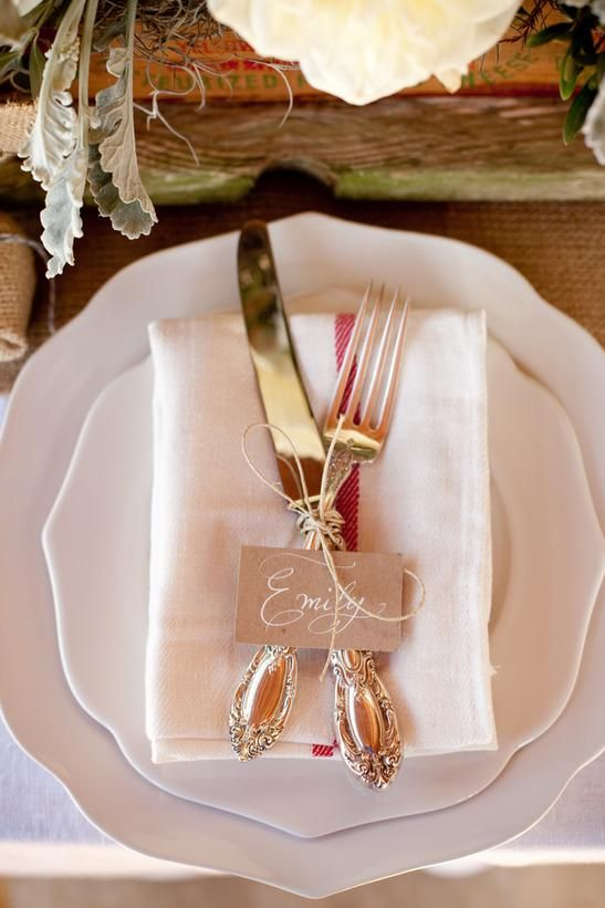 DIY Projects and Ideas for Creating a Rustic-Style Wedding: White dinnerware, napkins made from dishtowels and heirloom silver tied with twine make an elegant, yet casual look. To make the place card, cut craft paper cardstock into small tags, and write guests names in a pretty script. (calligraphy by Pretty Pen Jen.) From DIYnetwork.com