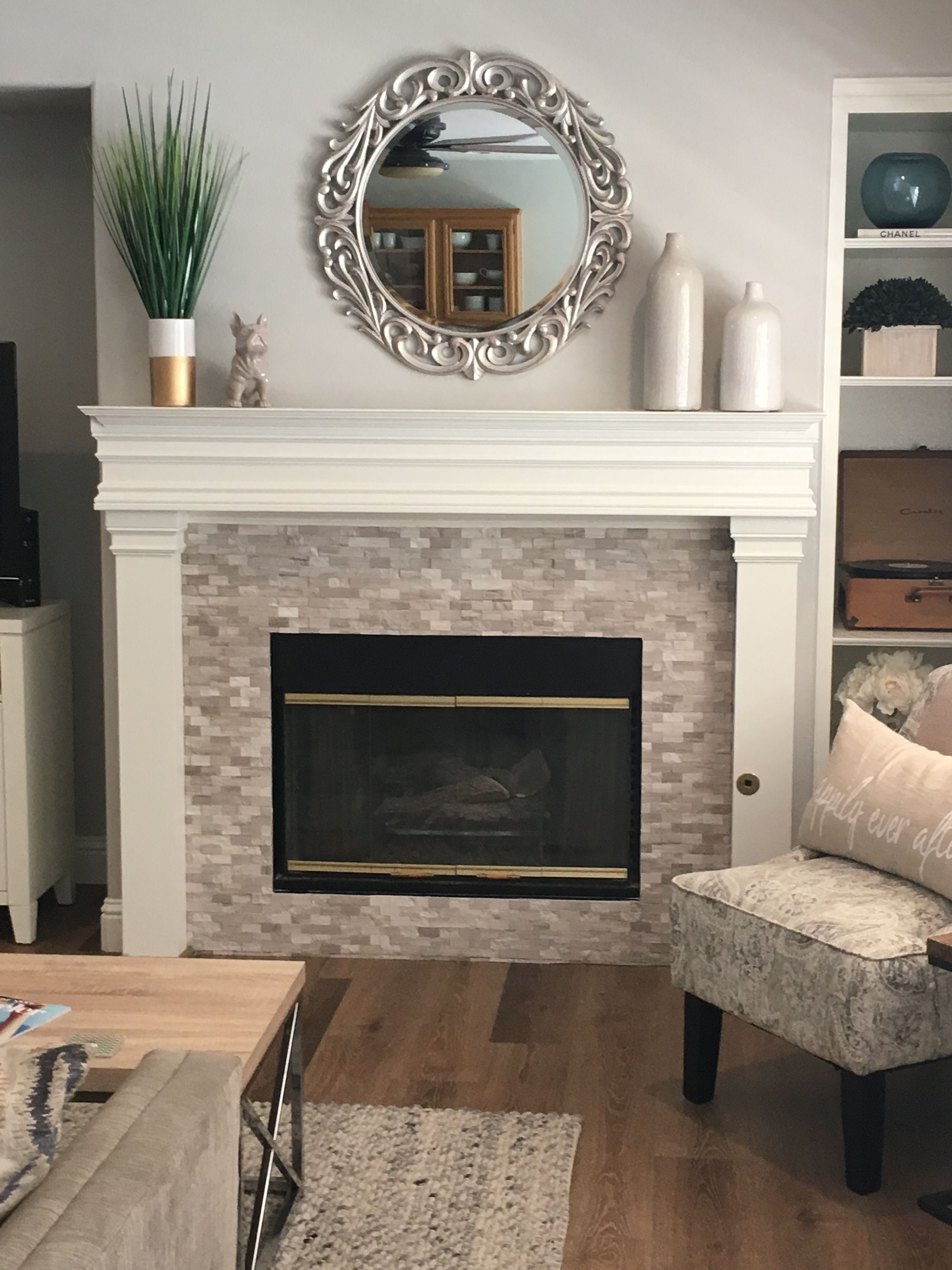 Small Stacked Stone Fireplace Surround Installed Right Over