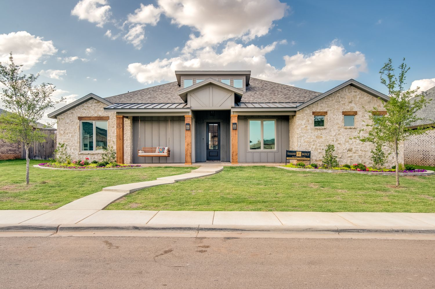 With A Generous Front Porch And Natural Stone This Inviting Home Beacons Friend And Family Inviting Home Home Focus House Styles