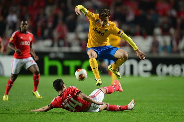 Miralem Sulejmani of Juventus battles with Maxi Pereira of Benfica during the UEFA Europa League Semi Final between SL Benfica and Juventus ...
