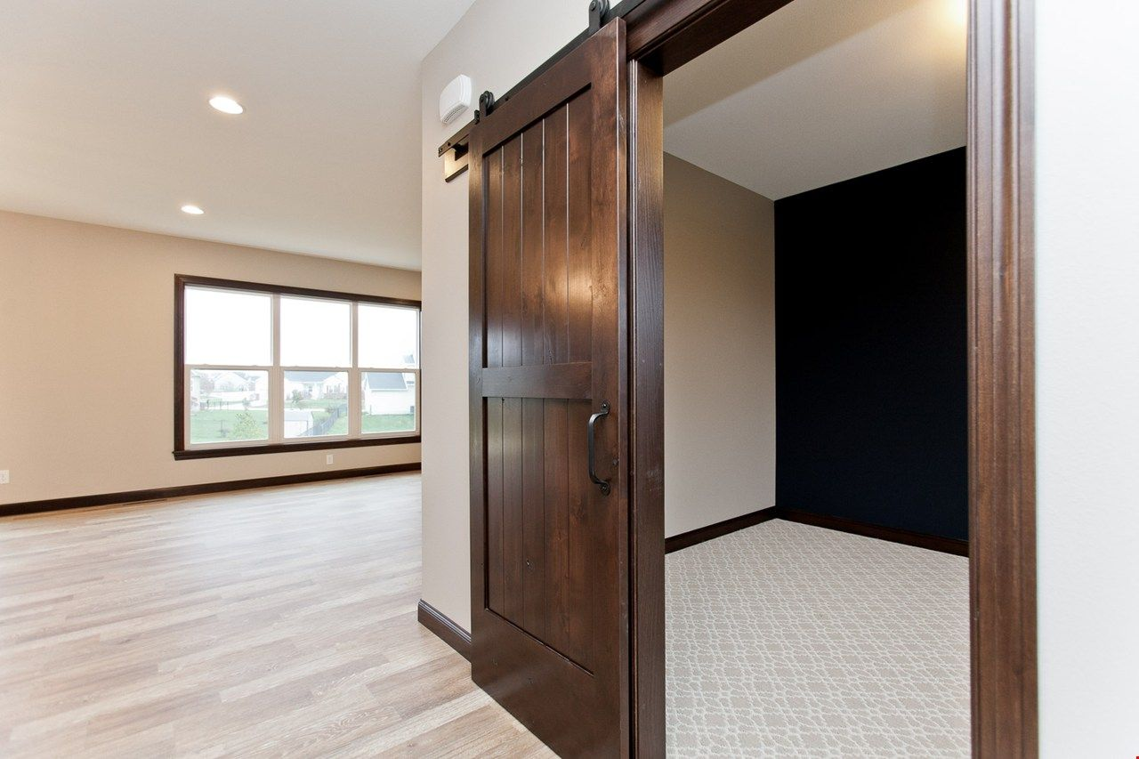 Barn Door Closes Off Flex Room In This New Construction Home In Cedar Rapids Ia By Skogman Homes Home New Homes Flex Room