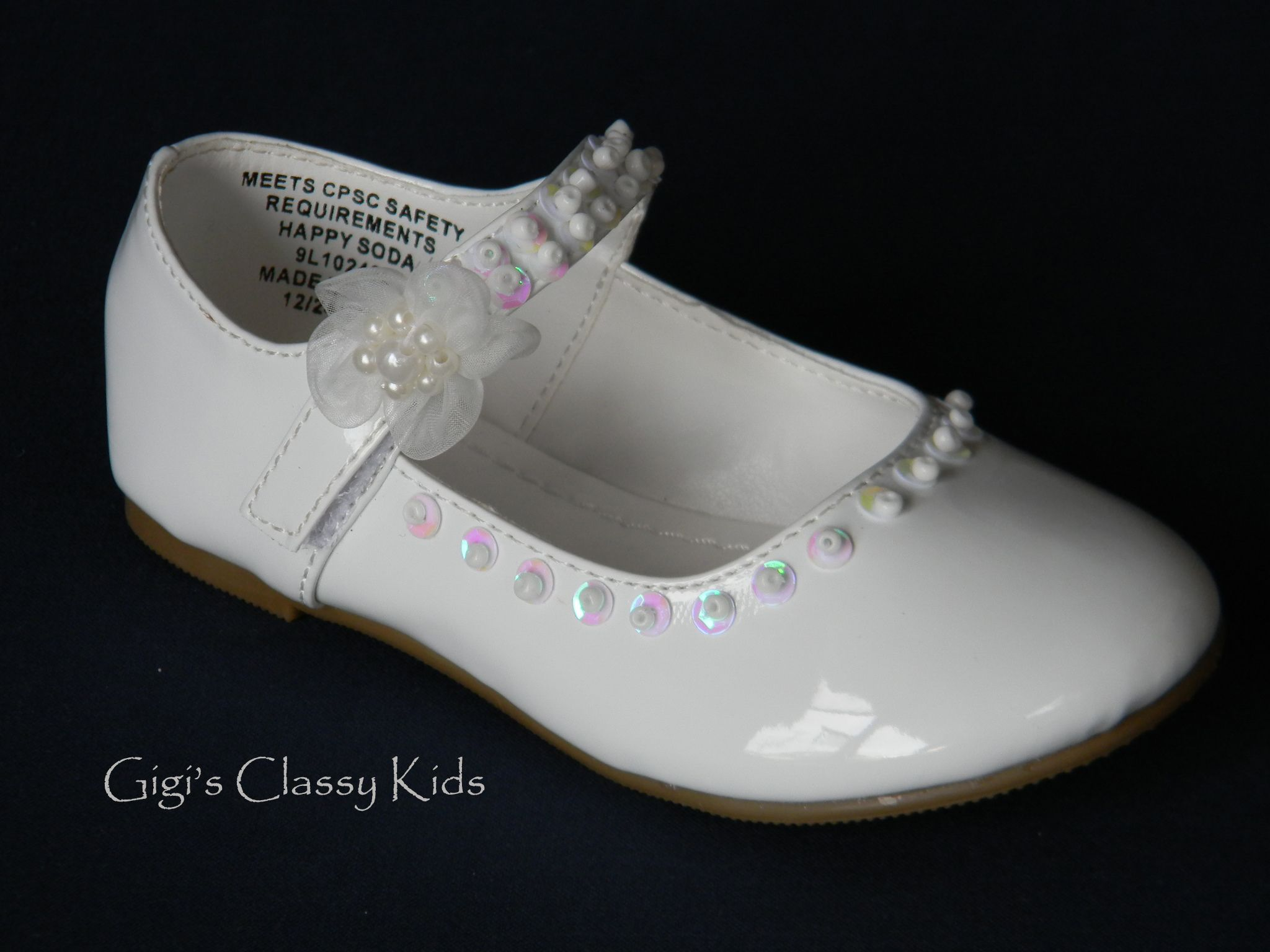 Beautiful baby girl white dress shoes.