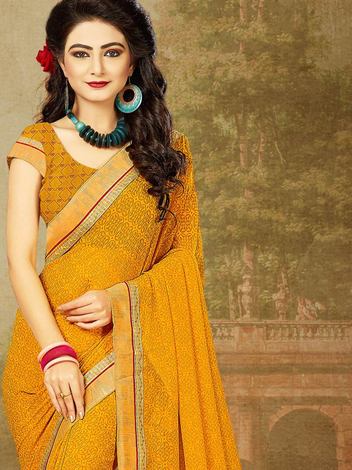 Stunning orange georgette casual wear designer saree having fabric