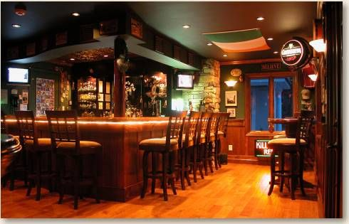 Entire Garage Space Converted Into This Amazing Irish Pub Style Home Bar